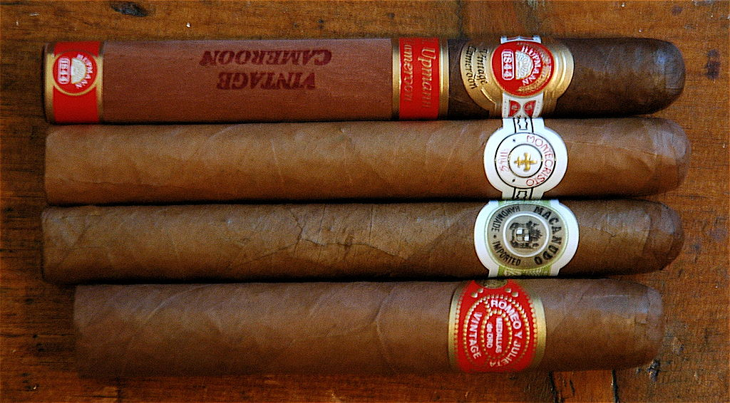 Four premium cigars of various brands (from top: H. Upmann, Montecristo, Macanudo, Romeo y Julieta)  Photo by Dan Smith. (Wikimedia Commons)